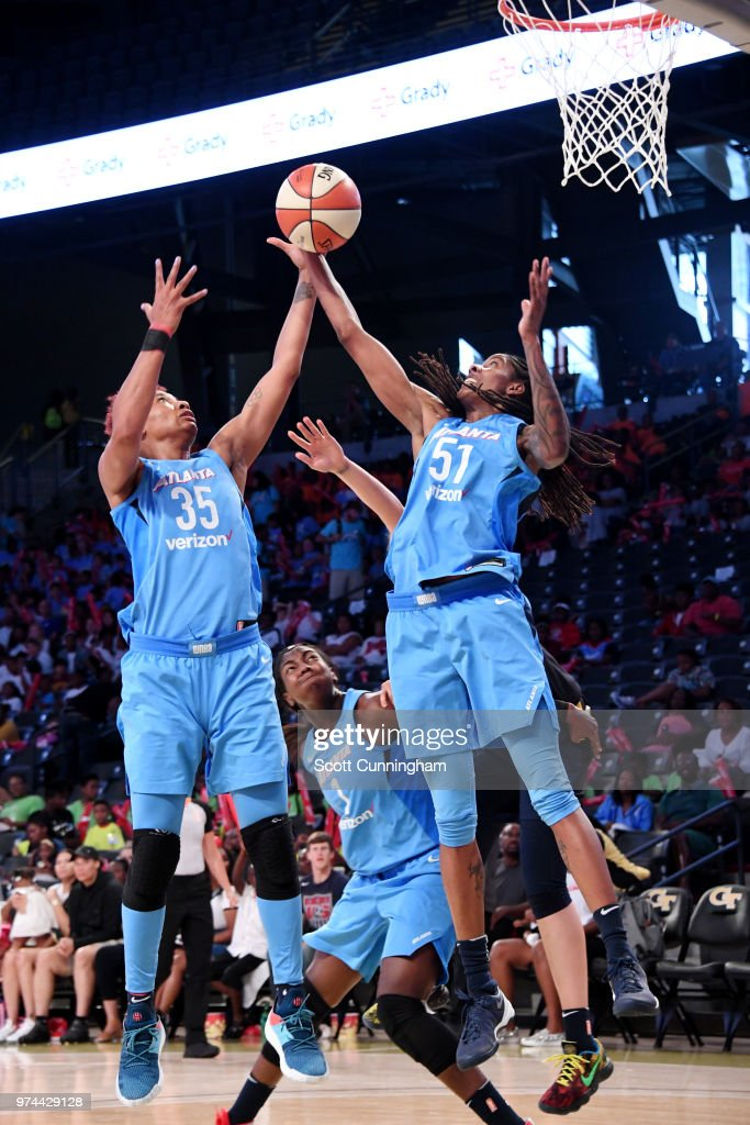 Angel McCoughtry #35 and Jessica Breland #51 of the Atlanta Dream rebound the ball against the Indiana Fever on June 14, 2018 at Hank McCamish Pavilion in Atlanta, Georgia.