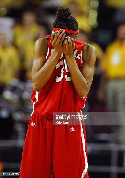 Angel McCoughtry of Louisville covers her eyes in dejection after fouling out in the final minute of 67-58 loss to Arizona State in NCAA Women's...
