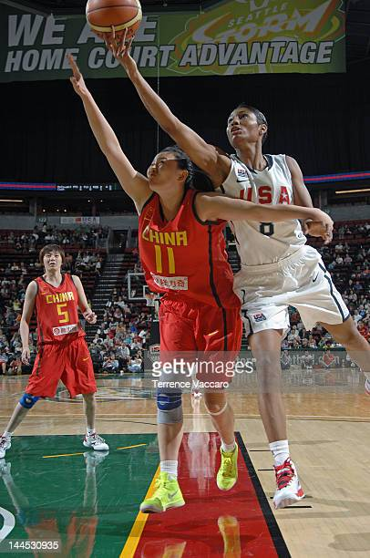 Angel McCoughtry of the 2012 USA Basketball Women's National Team grabs the ball against Ma Zengyu of the 2012 China Women's National Team during the...