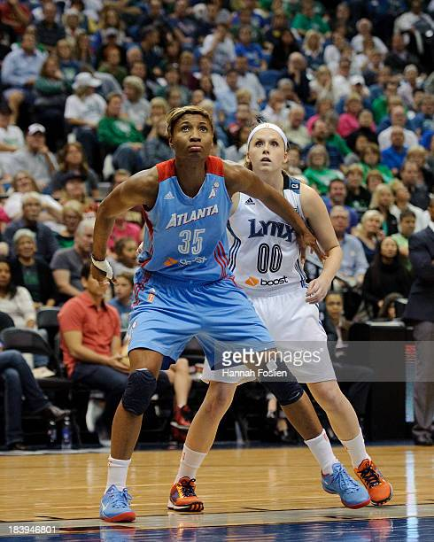 Angel McCoughtry of the Atlanta Dream and Lindsey Moore of the Minnesota Lynx watch a free throw during Game Two of the 2013 WNBA Finals on October 8...