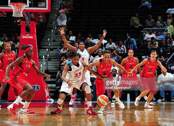 Angel McCoughtry of the Atlanta Dream battles for a loose ball against Jasmine Thomas of the Washington Mystics at Philips Arena on September 2 2011...