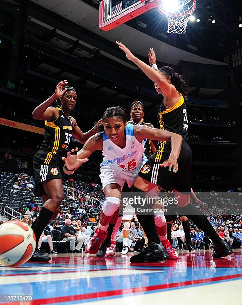 Angel McCoughtry of the Atlanta Dream battles for a loose ball against the Tulsa Shock at Philips Arena on September 4, 2011 in Atlanta, Georgia....