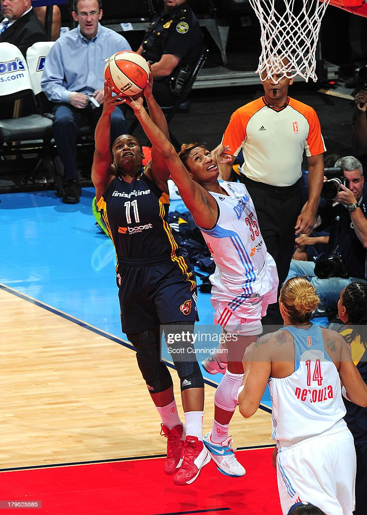 Angel McCoughtry #35 of the Atlanta Dream battles for a rebound against Karima Christmas #11 of the Indiana Fever at Philips Arena on September 4 2013 in Atlanta, Georgia.
