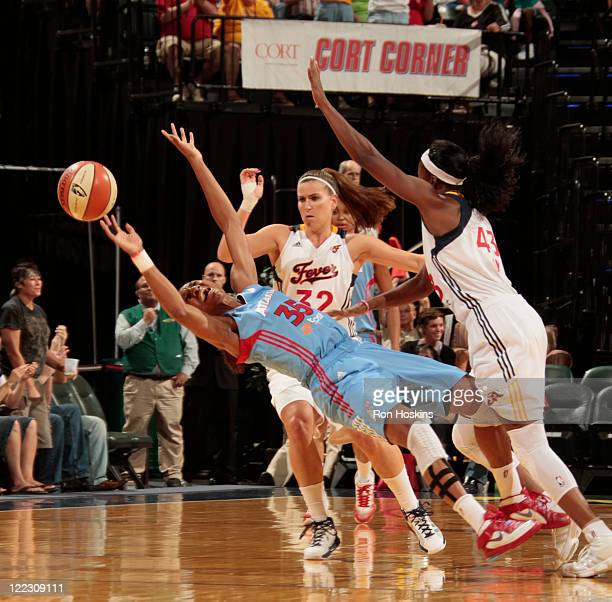 Angel McCoughtry of the Atlanta Dream battles Jeanette Pohlen and Shyra Ely of the Indiana Fever at Conseco Fieldhouse on August 27 2011 in...