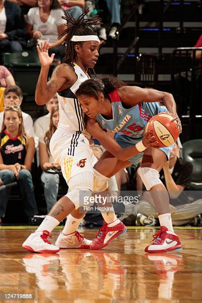 Angel McCoughtry of the Atlanta Dream battles Shavonte Zellous at Conseco Fieldhouse on September 11 2011 in Indianapolis Indiana NOTE TO USER User...