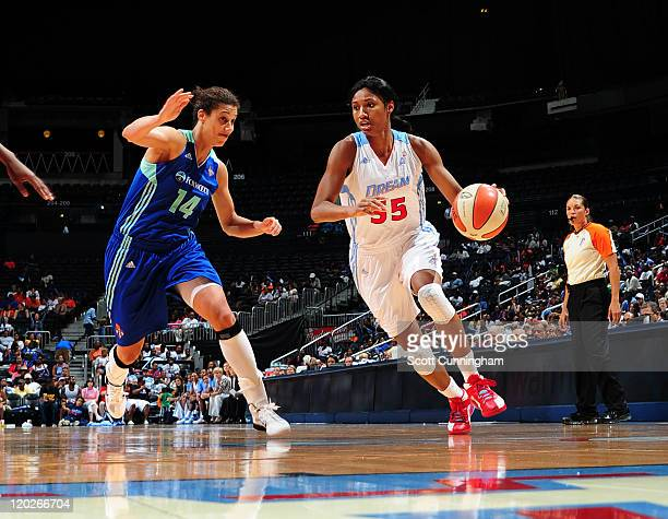 Angel McCoughtry of the Atlanta Dream drives against Nicole Powell of the New York Liberty at Philips Arena on August 2 2011 in Atlanta Georgia NOTE...