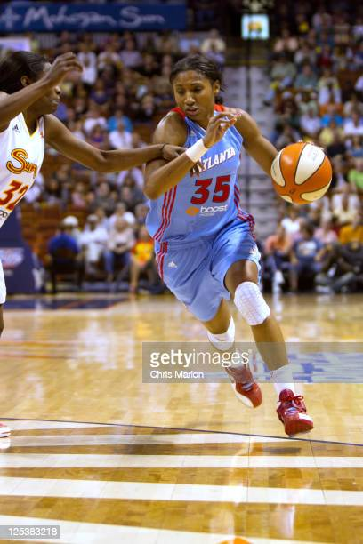 Angel McCoughtry of the Atlanta Dream drives the ball in front of Kalana Greene of the Connecticut Sun in Game One of the Eastern Conference...