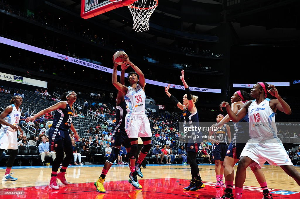 Angel McCoughtry #35 of the Atlanta Dream drives to the basket against the Connecticut Sun on July 29, 2014 at Philips Arena in Atlanta, Georgia.
