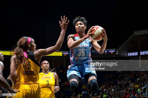 Angel McCoughtry of the Atlanta Dream drives to the basket against Glory Johnson of the Tulsa Shock during the WNBA game on July 29 2014 at the BOK...