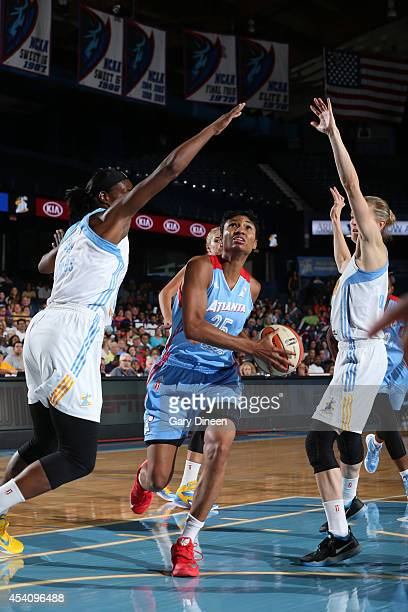 Angel McCoughtry of the Atlanta Dream drives to the basket against Sylvia Fowles and Courtney Vandersloot of the Chicago Sky in Game Two of the...