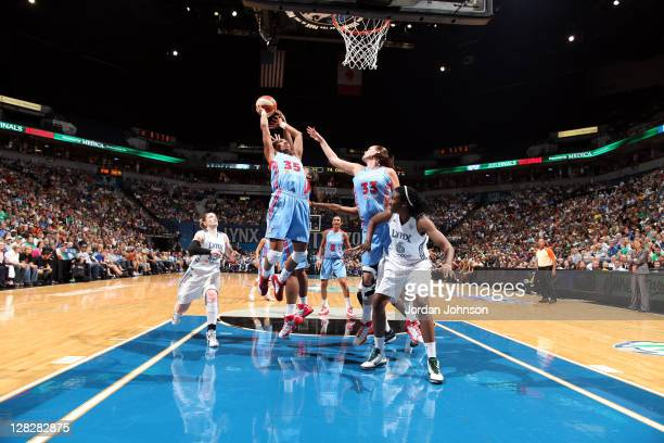 Angel McCoughtry of the Atlanta Dream grabs for the rebound against the Minnesota Lynx in Game Two of the 2011 WNBA Finals on October 5 2011 at...