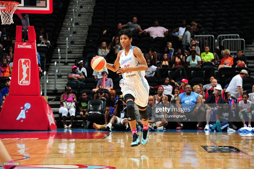 Angel McCoughtry #35 of the Atlanta Dream handles the ball against the Connecticut Sun on July 29, 2014 at Philips Arena in Atlanta, Georgia.