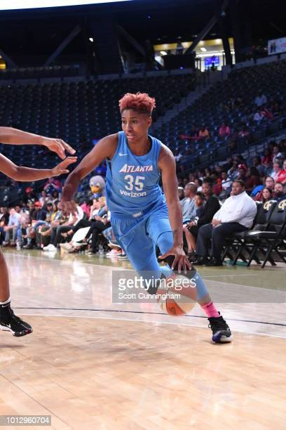 Angel McCoughtry of the Atlanta Dream handles the ball during the game against the Las Vegas Aces on August 07 2018 at McCamish Pavilion in Atlanta...