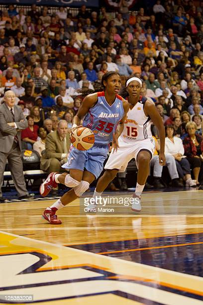 Angel McCoughtry of the Atlanta Dream looks for her shot in front of Asjha Jones of the Connecticut Sun in Game One of the Eastern Conference...