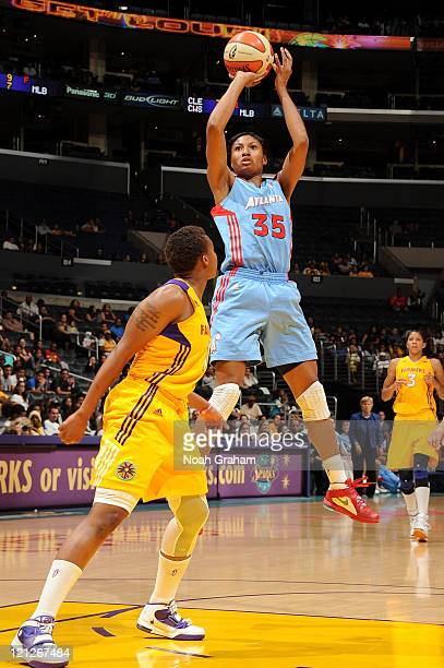 Angel McCoughtry of the Atlanta Dream puts up a shot over Natasha Lacy of the Los Angeles Sparks during a game at Staples Center on August 16 2011 in...
