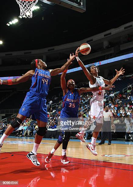 Angel McCoughtry of the Atlanta Dream rebounds during Game Two of the WNBA Eastern Conference Semifinals against Cheryl Ford and Taj McWilliams of...