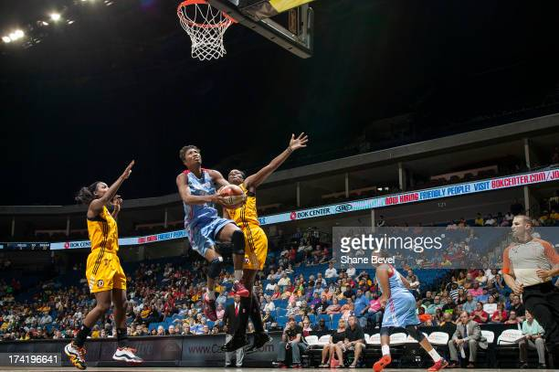 Angel McCoughtry of the Atlanta Dream shoots against Candice Wiggins and Tiffany JacksonJones of the Tulsa Shock during the WNBA game on July 21 2013...