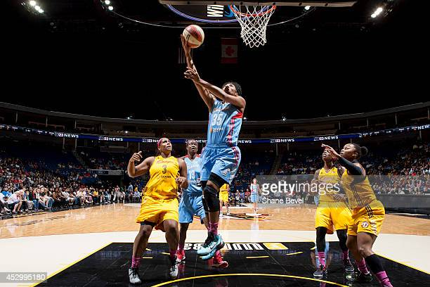 Angel McCoughtry of the Atlanta Dream shoots against Courtney Paris of the Tulsa Shock during the WNBA game on July 31 2014 at the BOK Center in...