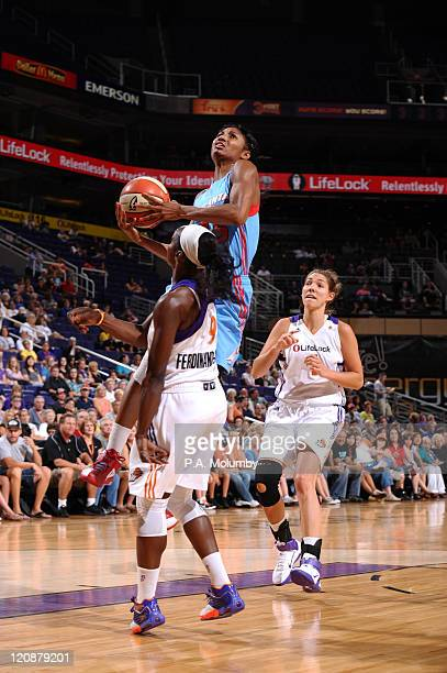 Angel McCoughtry of the Atlanta Dream shoots against Marie FerdinandHarris of the Phoenix Mercury on August 11 2011 at US Airways Center in Phoenix...