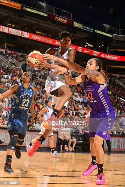 Angel McCoughtry of the Eastern Conference AllStars drives against Brittney Griner of hte Western Conference AllStars during the 2014 Boost Mobile...