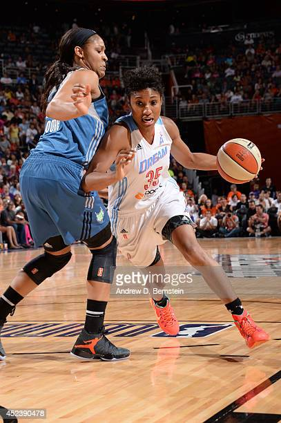Angel McCoughtry of the Eastern Conference AllStars drives to the basket against Maya Moore of the Western Conference AllStars during the 2014 Boost...