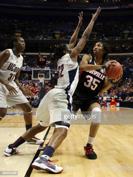 Angel McCoughtry of the Louisville Cardinals heads for the net as Kalana Greene of the Connecticut Huskies defends on April 7, 2009 during the NCAA...