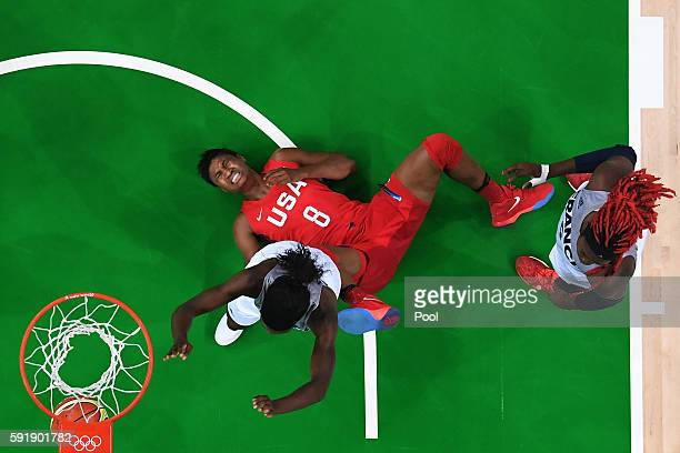 Angel Mccoughtry of the United States shoots against Laetitia Kamba of France during a Women's Semifinal Basketball game between the United States...