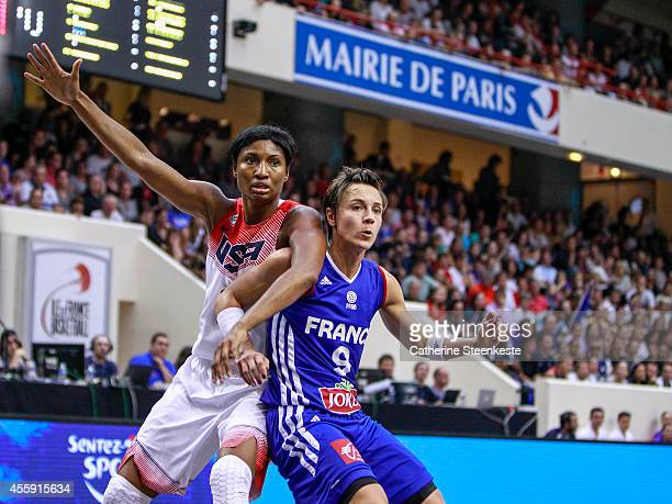 Angel McCoughtry of the USA Basketball Women's National Team is defending on Celine Dumerc of the French Basketball Women's National Team during the...