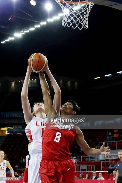 Angel Mccourghtry of USA vies with her rival during the 2014 FIBA World Championship For Women Group D basketball match between USA and China at Abdi...