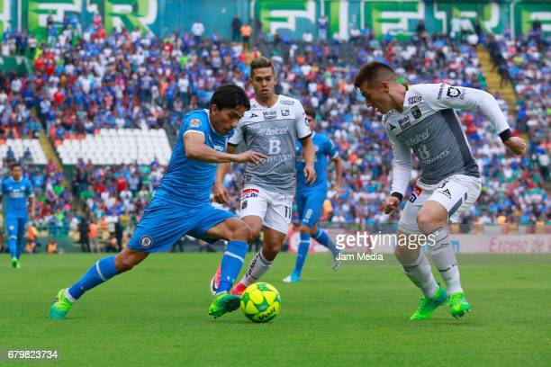 Angel Mena of Cruz Azul and Elias Hernandez of Leon fight for the ball during the 17th round match between Leon and Cruz Azul as part of the Torneo...