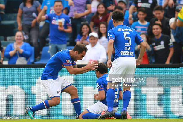 Angel Mena of Cruz Azul celebrates with teammates after scoring the third goal of his team during the 11th round match between Cruz Azul and Pachuca...