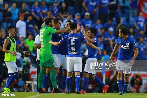 Angel Mena of Cruz Azul celebrates with teammates after scoring the fifth goal of his team during the 11th round match between Cruz Azul and Pachuca...