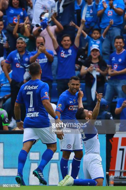 Angel Mena of Cruz Azul celebrates with teammates after scoring the second goal of his team during the 16th round match between Cruz Azul and Morelia...