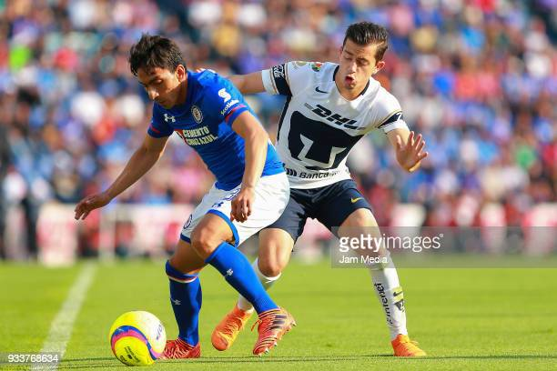Angel Mena of Cruz Azul fights for the ball with Alan Mozo of Pumas during the 12th round match between Cruz Azul and Pumas UNAM as part of the...