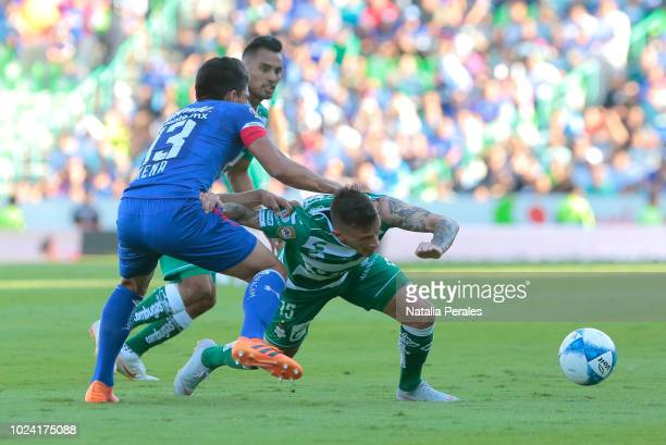 Angel Mena of Cruz Azul fights for the ball with Brian Lozano of Santos during the 7th round match between Santos Laguna and Cruz Azul as part of the...