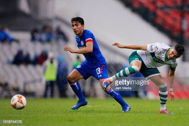 Angel Mena of Cruz Azul fights for the ball with Josue Lazaro of Zacatepec during a match between Cruz Azul and Zacatepec as part of Copa MX Apertura...