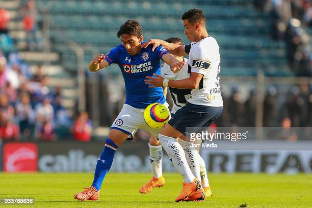 Angel Mena of Cruz Azul fights for the ball with Pablo Barrera of Pumas during the 12th round match between Cruz Azul and Pumas UNAM as part of the...