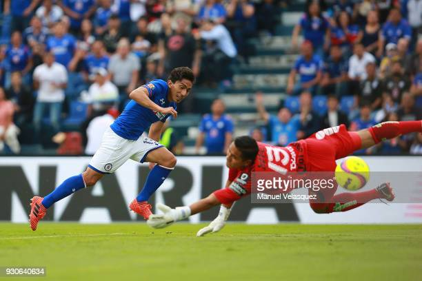 Angel Mena of Cruz Azul shoots on target and scores the third goal of his team during the 11th round match between Cruz Azul and Pachuca as part of...