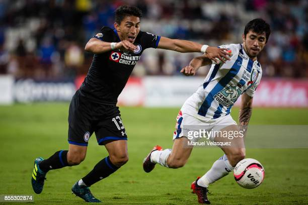Angel Mena of Cruz Azul struggles for the ball against Edson Puch of Pachuca during the 11th round match between Pachuca and Cruz Azul as part of the...