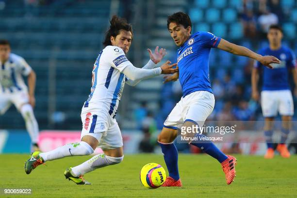 Angel Mena of Cruz Azul struggles for the ball against Jorge Hernandez of Pachuca during the 11th round match between Cruz Azul and Pachuca as part...