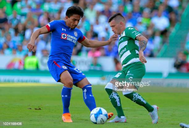 Angel Mena of Cruz Azul struggles for the ball with Brian Lozano of Santos during the 7th round match between Santos Laguna and Cruz Azul as part of...