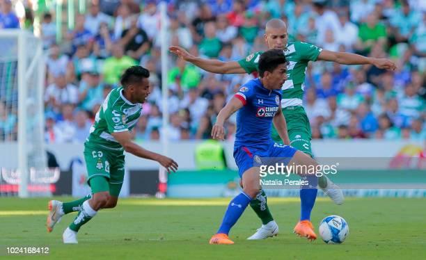 Angel Mena of Cruz Azul struggles for the ball with Matheus Doria of Santos during the 7th round match between Santos Laguna and Cruz Azul as part of...