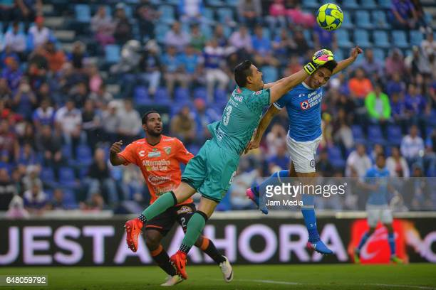 Angel Mena of Cruz is fouled by goalkeeper Moises Munoz of Jaguares during the 9th round match between Cruz Azul and Chiapas as part of the Torneo...