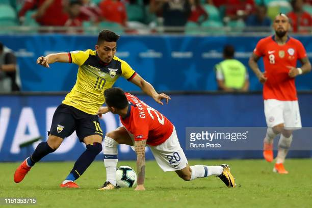 Angel Mena of Ecuador struggles for the ball with a Charles Aranguiz of Chile during the Copa America Brazil 2019 group C match between Ecuador and...