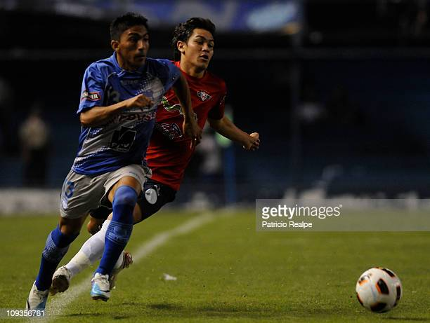 Angel Mena of Emelec struggles for the ball with Amilcar Sanchez of Wilstermannl during a match as part of the Santander Libertadores Cup at the...