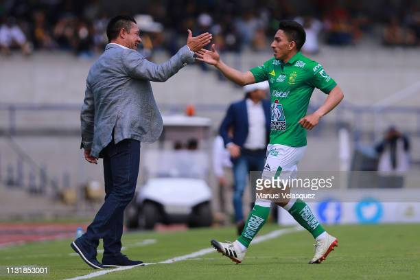 Angel Mena of Leon celebrates a scored goal with his coach Ignacio Ambriz during the 8th round match between Pumas UNAM and Leon as part of the...