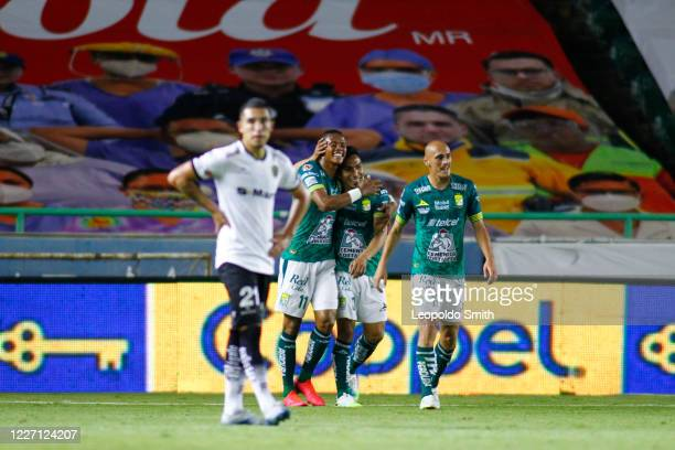 Angel Mena of Leon celebrates after scoring the third goal of his team with Yairo Moreno and Nicolas Sosa during a match between Leon and FC Juarez...