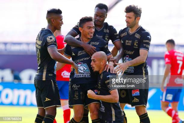 Angel Mena of Leon celebrates with teammates after scoring the first goal of his team during the 12th round match between Atletico San Luis and Leon...