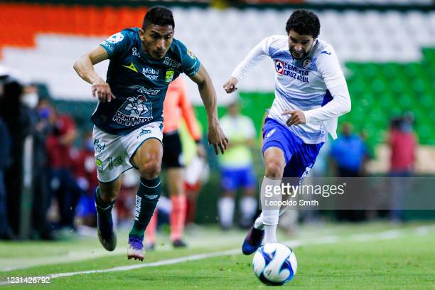 Angel Mena of Leon, compete for the ball with Jose Rivero of Cruz Azul during the 8th round match between Leon and Cruz Azul as part of the Torneo...