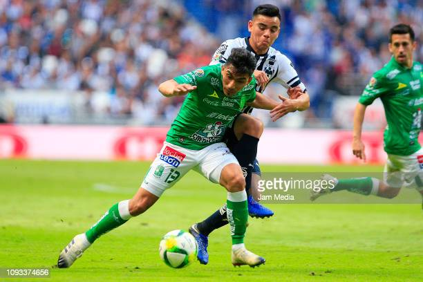 Angel Mena of Leon fights for the ball with Carlos Rodriguez of Monterrey during the 2nd round match between Monterrey and Leon as part of the Torneo...